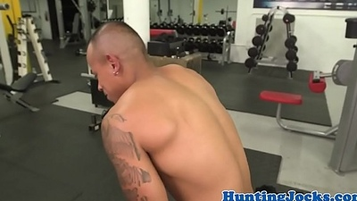 Finelooking fitness hunks romping at the gym