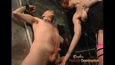 Dominatrix uses a whip beyond a stud and fetters his cock up
