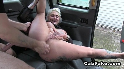 Blonde in lay eyes on through shirt in fake taxi