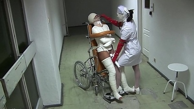 Patient in Wheelchair with Broken Legs increased by Straitjacket - TheWhiteWard.com