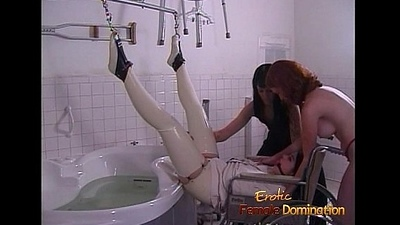 Latex-clad stunner pleasures their way exasperation with a toy to the fore receiving an enema